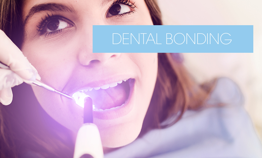 dentist repairing tooth using UV light